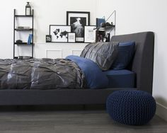 Elegant bachelor bedroom! Deep blue and rich grey colours make this an elegant and masculine bedroom.