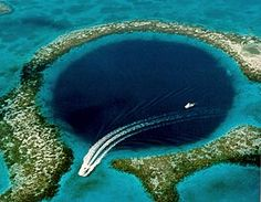 The Great Blue Hole Belize City, Belize. The Blue Hole is located 45 miles due east of Ambergris Caye and is located at Lighthouse Reef Atoll. The Blue Hole is accesible from Ambergris Caye by several operators whom offer full day trips and dives Places Around The World, Oh The Places You'll Go, Places To Travel, Places To Visit, Travel Destinations, Travel Tours, Travel Deals, Great Blue Hole, Belize Barrier Reef