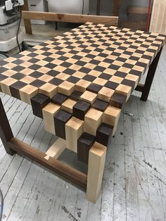 Walnut & Maple End Grain Coffee Table. Custom waterfall leg that gives the table its artistic and modern appeal. Table is made for all solid wood pieces. Table is finished with a Hard Oil Wax to keep its natural appeal. Would look great in any living room setting and is a great conversation piece. Dimensions- 39 Long x 23 Wide x 21 Tall   Please contact us for a shipping Quote