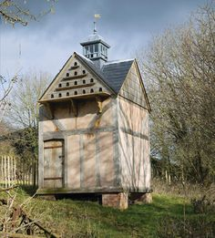 Dovecote English oak timber-framed dovecote with lath and lime render infill. Slate roof and lead cupola.