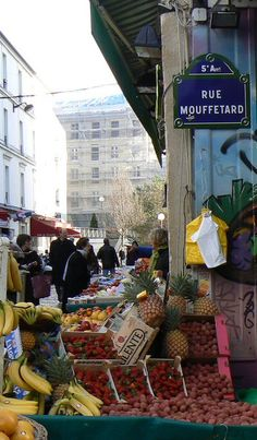 La rue Mouffetard, Rue Mouffetard is one of Paris's oldest and liveliest neighbourhoods. These days the area has many restaurants, shops, and cafés, and a regular open market. It is centered on the Place de la Contrescarpe, at the junction of the rue Mouffetard and the rue de Lacepede. Its southern terminus is at the Square Saint-Médard where there is a permanent open-air market.(Paris 5ème).