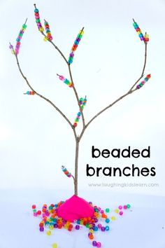 Fine motor activity that uses pony beads and a tree branch. Great activity for toddlers and preschoolers.