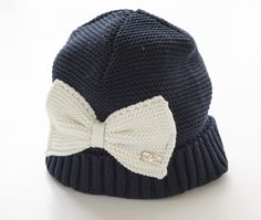 A-Dee navy winter hat with cream bow detail.