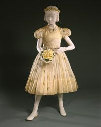 Grace Kelly's Flower Girl's Dress and Underdress, worn at Grace Kelly's Wedding, April 19, 1956. Made in Dallas, Texas. Designed by Joseph Hong, commissioned by Neiman-Marcus, made by Formals by Mary Carter, Dallas. Worn by Margaret Ann (Meg) Packer(then Meg Davis)