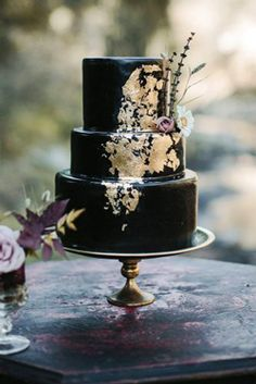 wedding cakes black Ideas For Amazing Wedding Cakes amazing wedding cakes black cake with gold is decorated with a lilac rose and chamomile tyler branch via Black Wedding Cakes, Lilac Wedding, Beautiful Wedding Cakes, Gorgeous Cakes, Wedding Colors, Contemporary Wedding Cakes, Dummy Cake, Halloween Wedding Cakes, Wedding Cake Prices