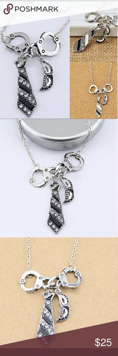 Coming soon fifty shades of grey necklace New untouched unopened sliver fifty shades of grey necklace Jewelry Necklaces