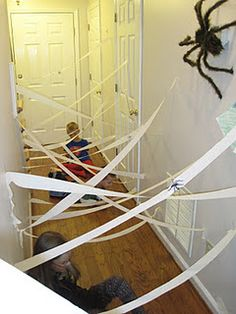 Streamers obstacle course - perfect for gross motor development... reminds us of The Matrix!