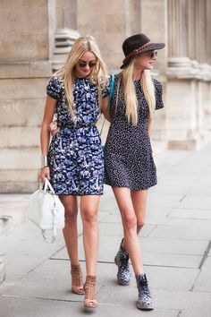 The Courtin-Clarins sisters at Paris Fashion Week (polka dot t-dress and Doc Martens for the nineties win)
