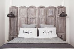 A grey colour scheme bedroom makeover with french and industrial styling and a french screen headboard