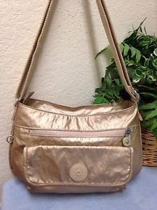 d3f2bd653ac2 Kipling Syro Metallic Gold Coated Canvas Travel Crossbody Bag Shoulder  Handbag