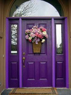Colourful Front Doors, Love the flowers and the door.  I could never do the whole house my favorite color purple but the front door.... yes please