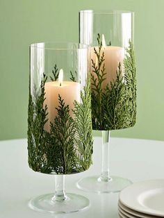 Go green with your candle display by adding flat pine needles.
