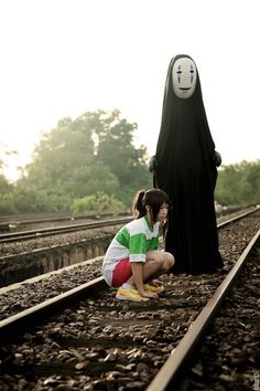 Chihiro & No Face cosplay from Spirited away! Very well done!