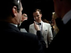 Benedict Cumberbatch and Naomi Watts get final instructions backstage before presenting an award.