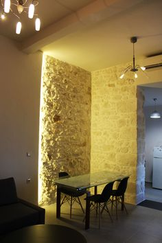 Spacious Minimal Apartment in Crete Greece Modern stone wall restoration  Crete Airbnb Rethimno