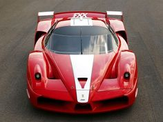This is a Ferrari FXX. This is a car of coolness, of power, of precision. This is a car that costs 1.8 million dollars. This is a car which you can't take home with you. It stays in the factory of Ferrari. You have to ask Ferrari if you can take it for a ride on a racetrack. After a couple of laps, they take it away.