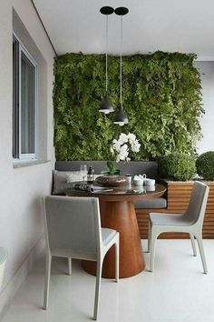balcony dining area with banquette and planted wall