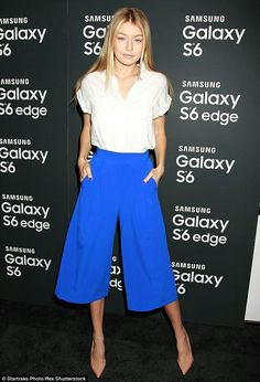 Seventies style: Gigi Hadid kept up with appearances as she arrived to the Samsung Galaxy launch in New York wearing a retro outfit on Tuesday night