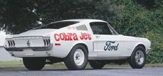 the 1968 Ford Mustang 428 Cobra Jet was the fastest pure-production Mustang of the era. The engine was based on the 428-cid engine used for racing, and also featured ram-air induction and a functional hood scoop
