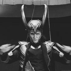 Loki rocking out (gif).