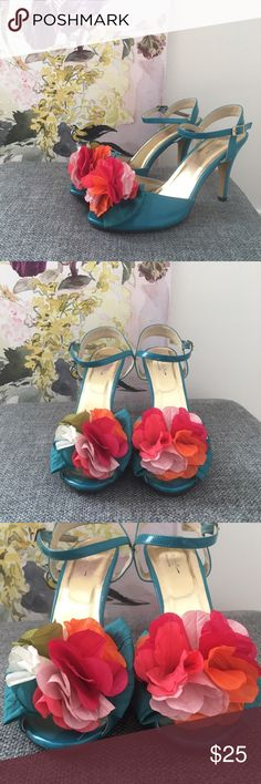 """Bright Blue Ballroom Dancing Shoes In a beautiful bright blue, these flamingo dancing shoes are a lovely piece. The manmade material and cloth flowers are lovely. In great condition. Small scuff on back of heel (pictured) 4"""" heel. 60124 Jaime Nicole Collection Shoes Heels"""
