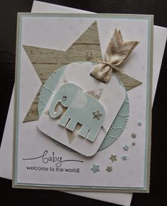 hand crafted baby card fro,m Paper Ecstasy .... luv the soft blue and kraft on white ... montage of several layers: star, circle tag, star (might be stenciled) and an elephant wth another star ... luv how she trailed little punched stars around the corner ... great artistic card ...
