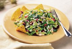 Mexican Tortilla Chicken Salad: the perfect summertime salad packed with kidney beans, corn chips, chicken, iceberg lettuce, chicken and shredded cheddar cheese. #recipe