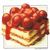 Cherry Icebox Cake - graham crackers layered with pudding/coolwhip mix, & topped with cherry pie filling.  Let sit overnight so the crackers become cake like and soft.