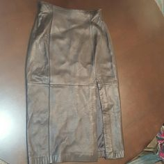 Lord& Taylor Leather Skirt Buttery soft leather skirt with slit at thigh. Says size 12 but fits more like 6/8 Lord & Taylor Skirts Midi