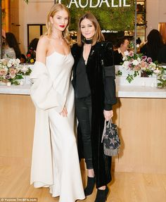 Black and white: Rosie and Olivia contrasted in their white and black outfits - December 6, 2017