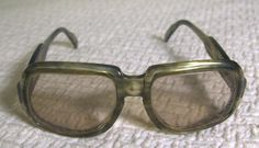 Groovy Vintage 1970s Big Green Marbled Sunglasses by ACTUELL Mineral Glasses/G3W Made In Germany. $57,00, via Etsy.