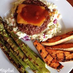 Made the loooong 7 mile trek from school to have dinner at home Grass-fed beef burger with sharp cheddar and a little bbq sauce, on top of homemade coleslaw, with grilled sweet potato wedges and grilled asparagus burger: 92/8 grass-fed ground beef formed into patties and seasoned with grill seasoning and garlic powder coleslaw: classic coleslaw mix with lite ranch, lite mayo, apple cider vinegar, salt, pepper, and stevia sweet potato wedges: sweet potatoes scrubbed clean then microw