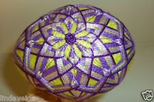Temari Egg created using Shades of Purple Thread over Lime Green