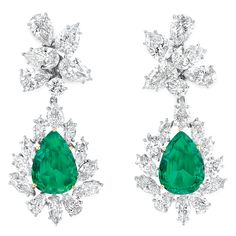 Pair of Diamond and Emerald Pendant-Earrings   Platinum, gold, topped by clusters of 10 pear-shaped and 2 round diamonds, suspending 2 pear-shaped emeralds approximately 13.00 cts., framed by 18 marquise and 6 pear-shaped diamonds, total approximately 19.50 cts., pendants detachable, approximately 18.6 dwt