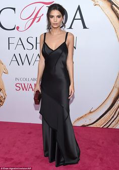 Red carpet ready: The supermodel sizzled in a lingerie-esque gown made of silky black mate...