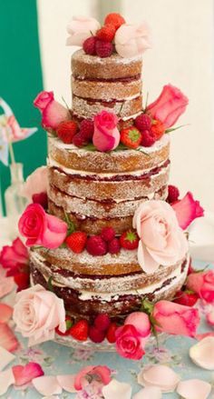 Perfect for a Summer Wedding - An unfrosted cake with beautiful fresh berries and roses