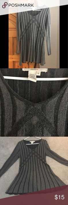 Grey knitt tunic top Fall and winter top. Looks  great with leggings and boots. Gored and flared at hip area gives a super flattering fit. Tops Tunics