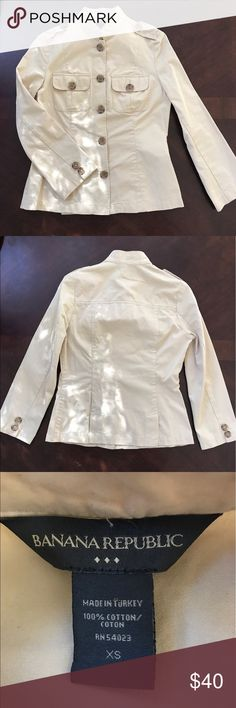 Banana Republic Button Down Top I'm OBSESSED with this tan Banana Republic top!!  This gorgeous top is fitted and has oversized brown buttons.  Lightweight cotton material. Banana Republic Tops