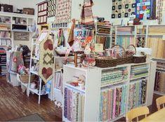 Color coordinated quilting shop display idea   Display Ideas ... : quilt fabric shops uk - Adamdwight.com