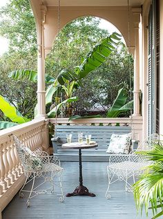 White wire outdoor furniture looks antique chic and lends an airy feel to this open veranda porch. Tour more of Sara Ruffin Costello's Striking and Stylish New Orleans Home on Our Style Guide here. Small Outdoor Spaces, Outdoor Rooms, Outdoor Living, Outdoor Decor, Outdoor Furniture, Outdoor Patios, Wicker Furniture, Outdoor Ideas, Fresco