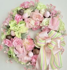 Thanks so much for stopping by and visit my creations. All my wreath is unique and created in highest quality.  This beautiful Spring, Easter flower door wreath sets on a nature grapevine wreath base.  The wreath is embellished with beautiful pink/white Peonies, lime green peony, pink and lime green Roses , pink/white baby breathes, pink, white, and lime green Hydrangeas. The wreath is accented with two pink Easter Bunny hats, four pink with white polka dots Easter Eggs, and four fa...