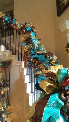 Peacock Christmas stair garland, with silver not gold = perfect! Christmas Garland On Stairs, Peacock Christmas Tree, Turquoise Christmas, Christmas Mantels, Blue Christmas, Beautiful Christmas, Christmas Themes, Christmas Holidays, Christmas Wreaths