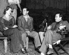 Director Frank Capra (left) visits Bette Davis and director William Wyler on the set of The Letter