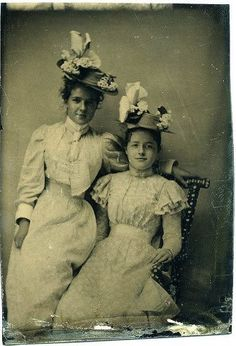 1890s cdv- both young ladies wearing boater hats w/ bows looped up and flowers. Pretty summer dresses