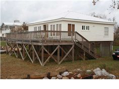 Cute cottage overlooking Mobile Bay! Boat launch approx. 2 miles north and 3 miles south. Bulkheaded with brand new wharf! Newly sodded yard as well. Large vaulted ceiling with small loft.  Fishing structures nearby!  One of the lowest priced cottages on the bay!