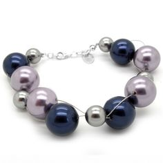 Small and big dark blue, silver and purple Swarovski® crystal Pearlsmake up this girly bracelet that hugs at the wrist. It is great for evening wear!
