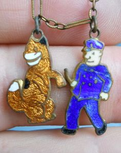 Antique Child's Costume Bracelet with Two Enameled Charms - Dog and Dog Catcher  This appears to be Sandy, Little Orphan Annie's dog, possibly 1930s/Depression Era. There may have been other characters on the bracelet as well. The other character is a cop, not a dog catcher.