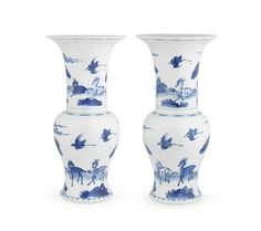 A pair of blue and white 'deer and cranes' 'phoenix-tail' vases, Kangxi period (1662-1722)