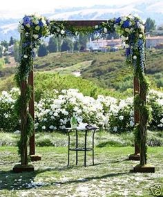 Blue, green and white rustic wedding chuppah or canopy