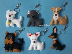 Chaveiros confeccionados em feltro, desenhados a partir de fotos dos cachorrinhos das clientes.     Fiz 03 deles, depois as meninas pedi...
